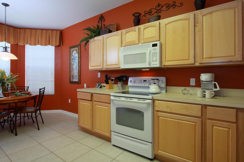 Fully equipped kitchen with adjacent casual dining area