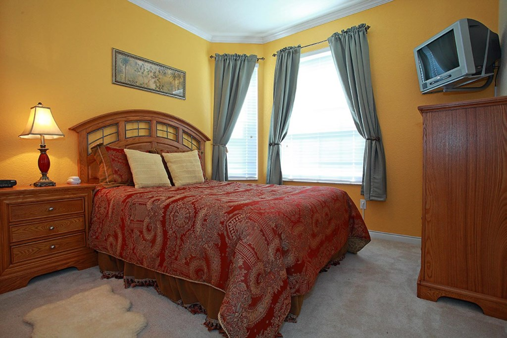 Ornate queen bedroom 2 includes a 20-inch TV