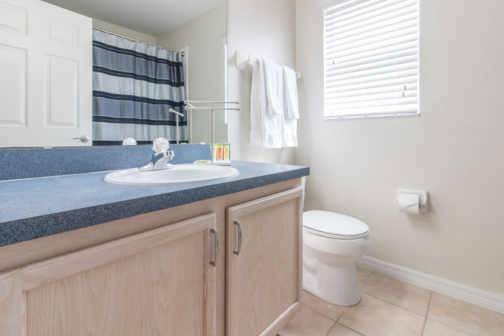 Shared hall bathroom with bathtub and shower