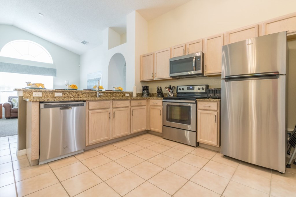 Newly remodeled fully equipped kitchen with stainless steel appliances