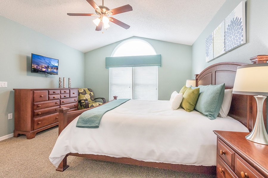 King master bedroom suite with flat screen TV and ceiling fan