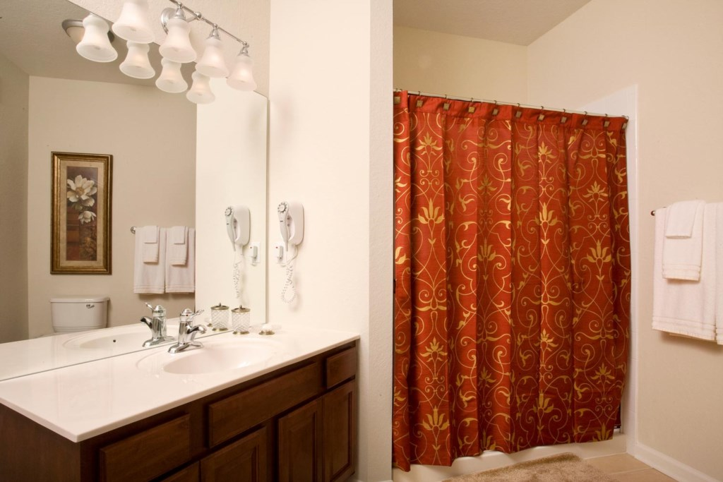 Suite 1 private bathroom with glass door curtained shower
