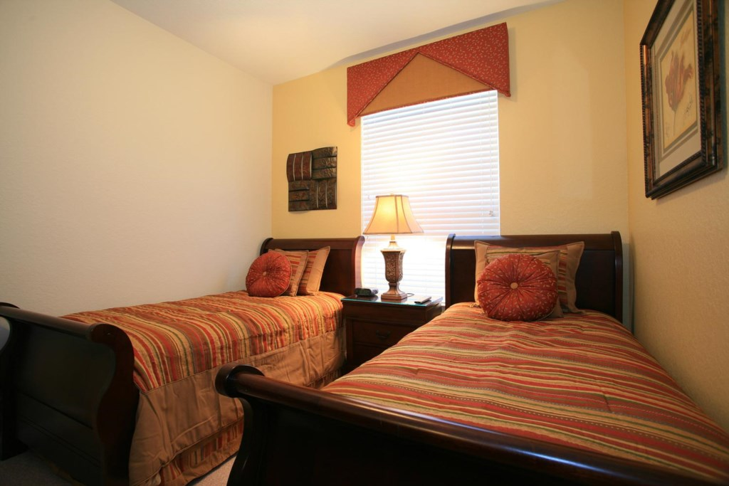 Bedroom 3 features two comfy twin beds