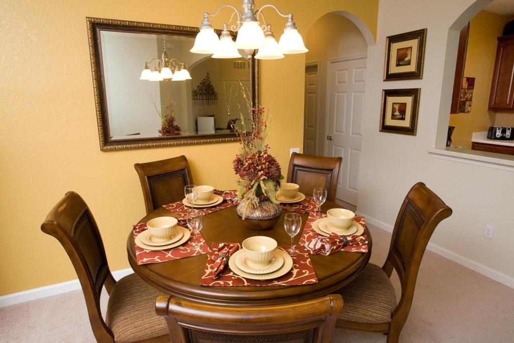 Quaint dining area seats five