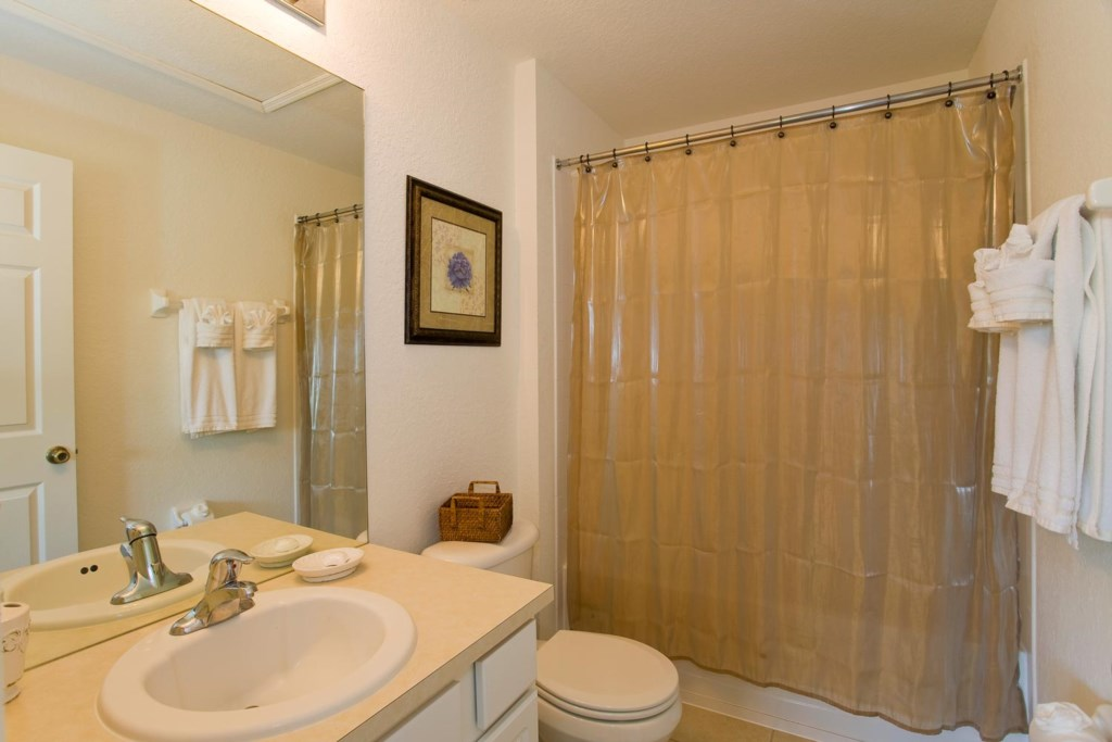 Bedroom 3 includes a private bathroom with bathtub & shower
