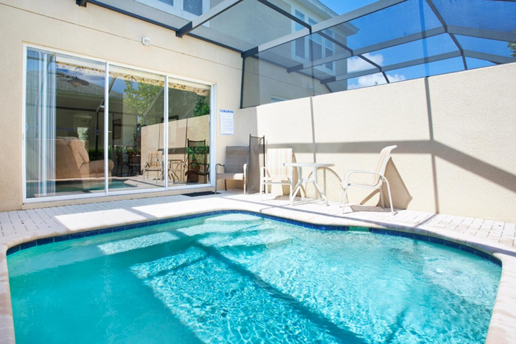 Private screened-in lounge pool & patio with outdoor furniture