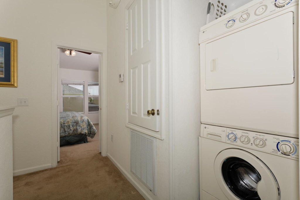 Fully equipped laundry area with washer and dryer