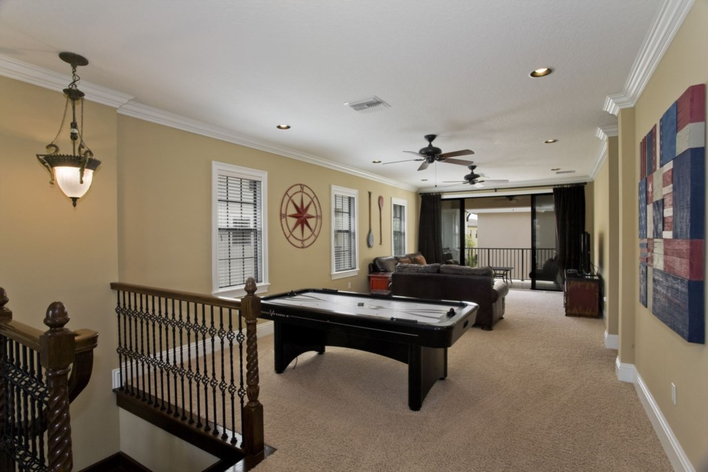 Upstairs loft game room with air hockey and a 50` TV Wii