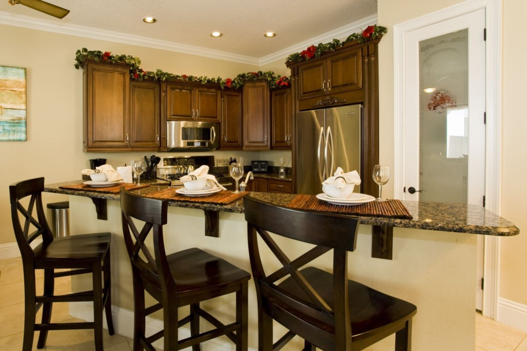 Beautiful kitchen with granite center island for chatting or dining