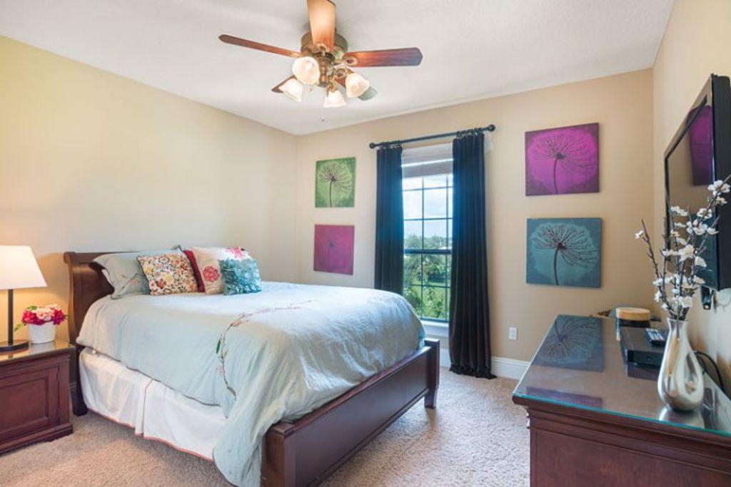 Second floor queen suite bedroom with twin trundle bed