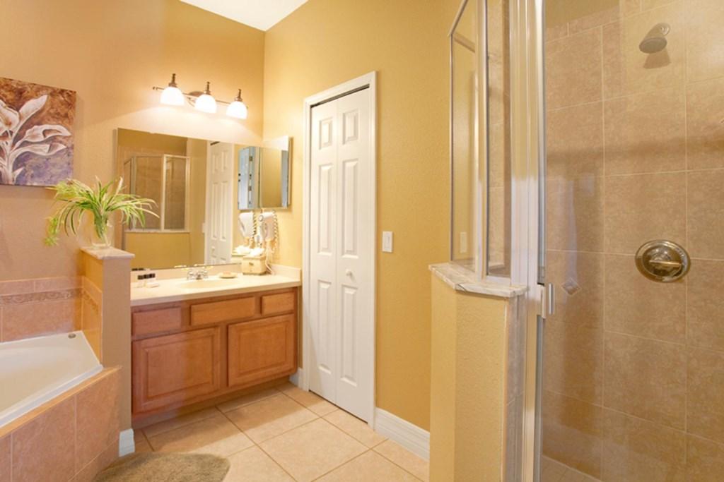 Suite 1 private bathroom with garden bathtub & glass door shower