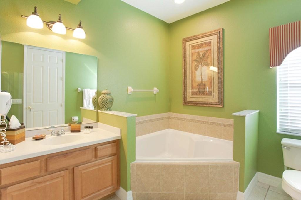 Suite 2 private bathroom with garden bathtub & glass door shower