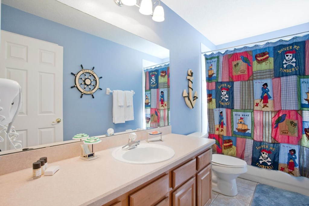Upstairs hall bathroom 6 with pirate decor plus a bathtub & shower