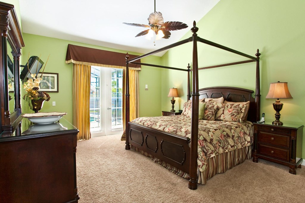 Stylish downstairs king suite 1 with 26-inch LCD TV/DVD combo & ceiling fan