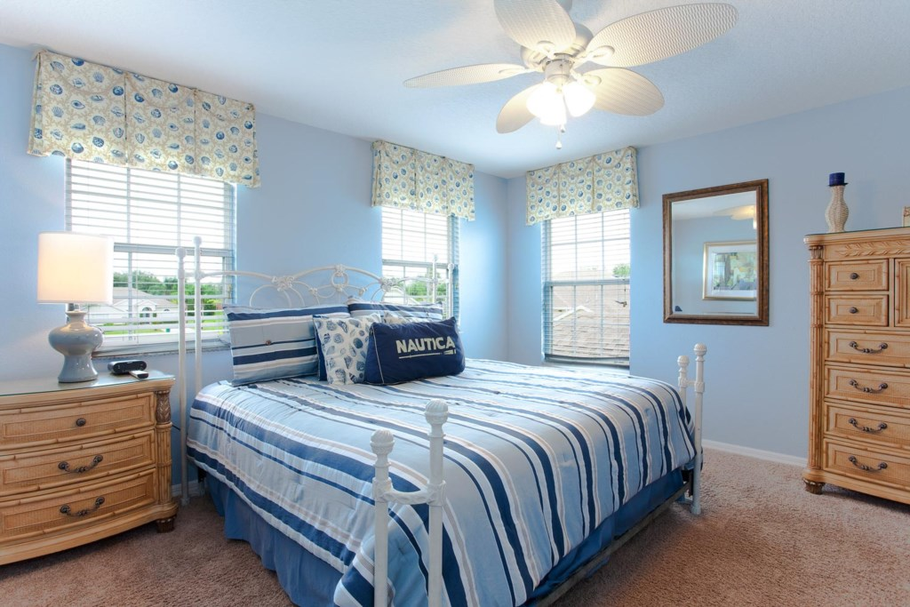 Inviting upstairs king suite 4 with 26-inch LCD TV/DVD combo & ceiling fan