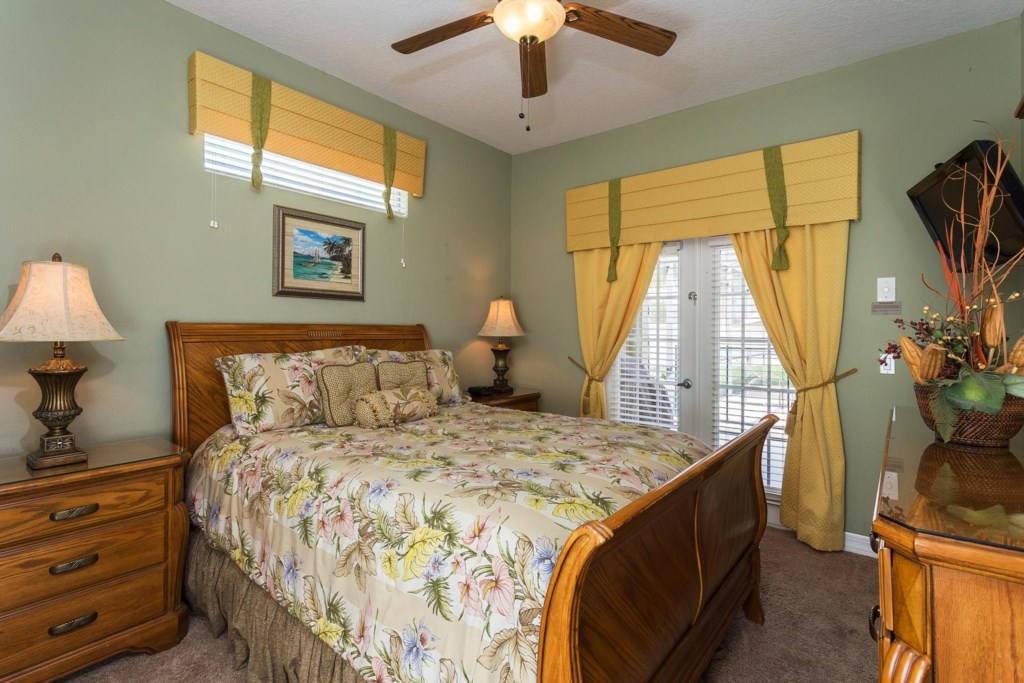 Cozy downstairs queen bedroom 5 with 26-inch LCD TV/DVD combo & ceiling fan