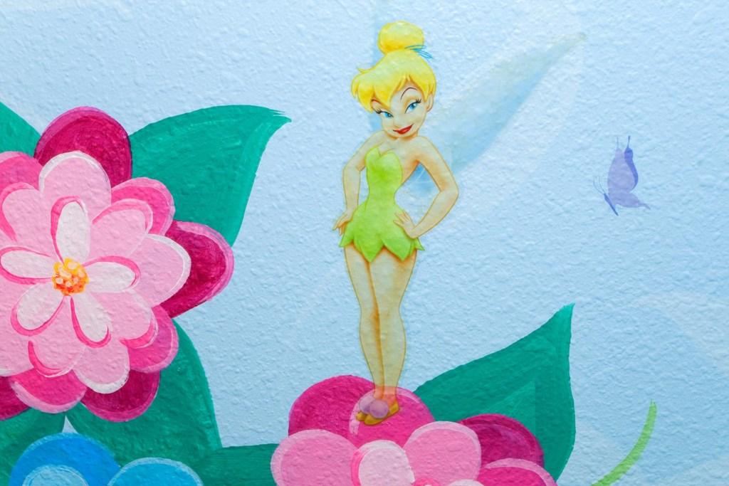 Girls will love the custom wall art featuring Tinkerbell