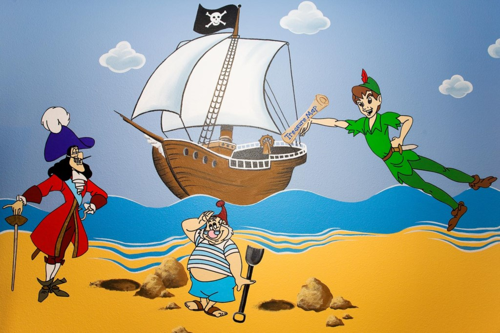 Boys will love the custom wall art featuring Peter Pan and Captain Hook