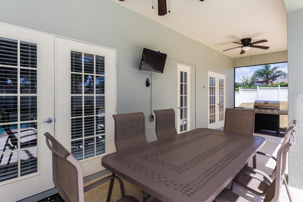 Outdoor patio dining area seats six and has a 26-inch flat-screen TV