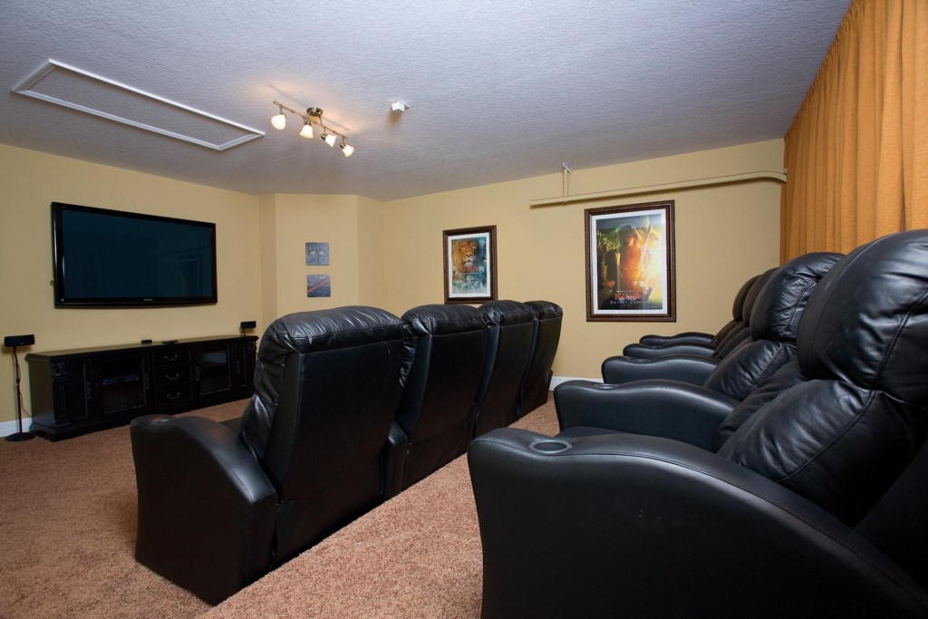 Home theater with 65-inch plasma TV, surround sound, theater seating and PS3