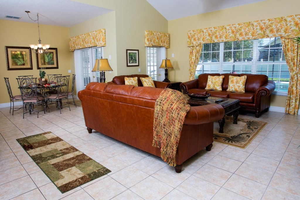 The living area also features direct pool/patio access