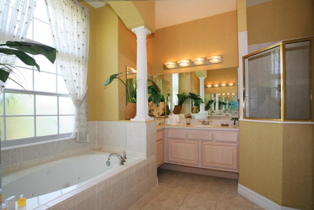 Downstairs main master bathroom with garden tub & glass door shower