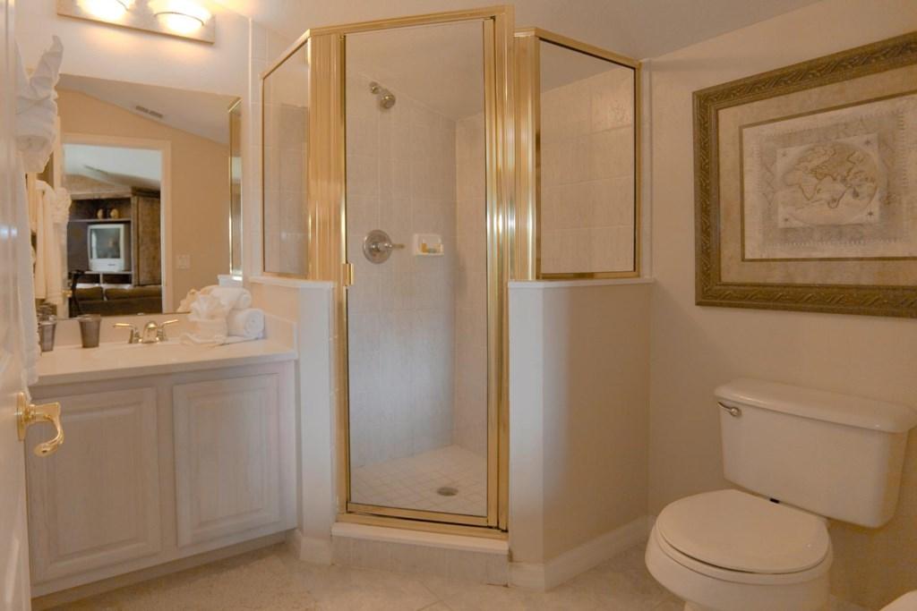 Upstairs master bathroom 2 with glass door shower
