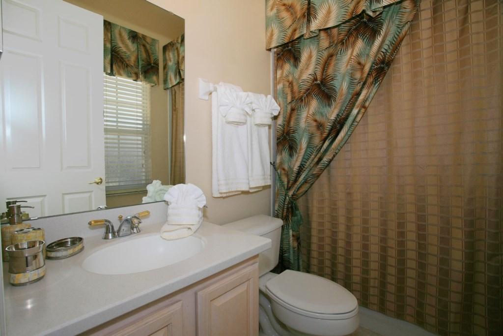 Downstairs master bathroom 3 with bathtub & shower
