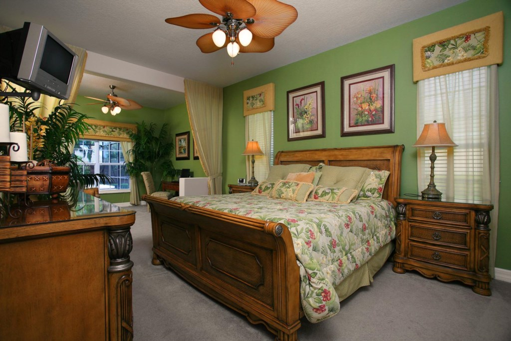 Lavish downstairs main king master suite with private sitting area, TV/VCR combo & ceiling fan