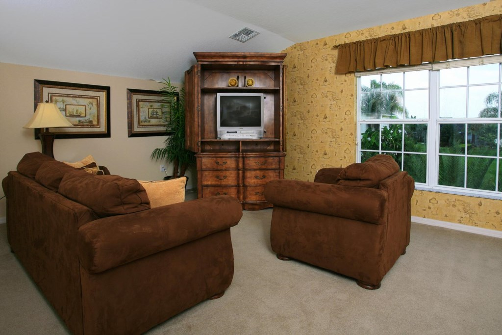 The upstairs master features a comfortable sitting area for your relaxation