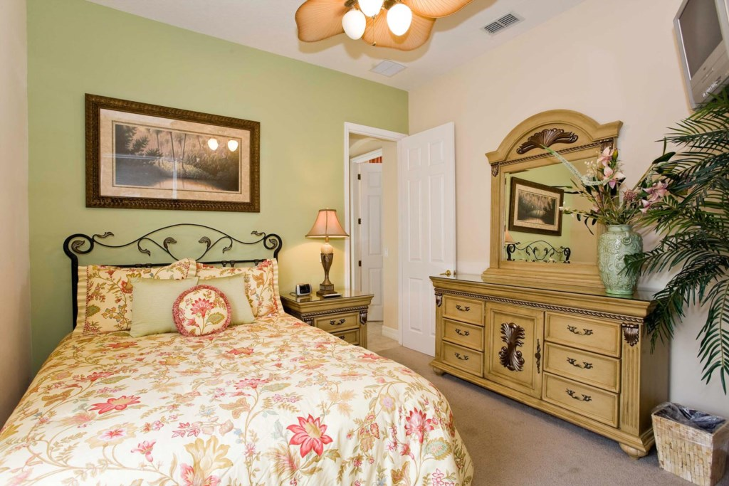 Stylish downstairs queen master suite 3 with TV/VCR combo & ceiling fan