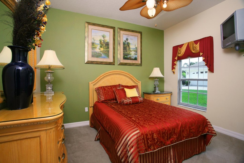 Lively downstairs queen bedroom 4 with TV/VCR combo & ceiling fan