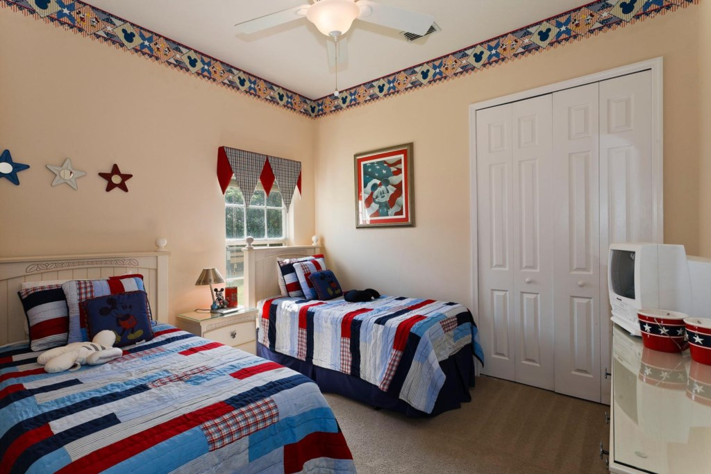 Fun downstairs twin bedroom 5 with Mickey decor and TV/VCR combo