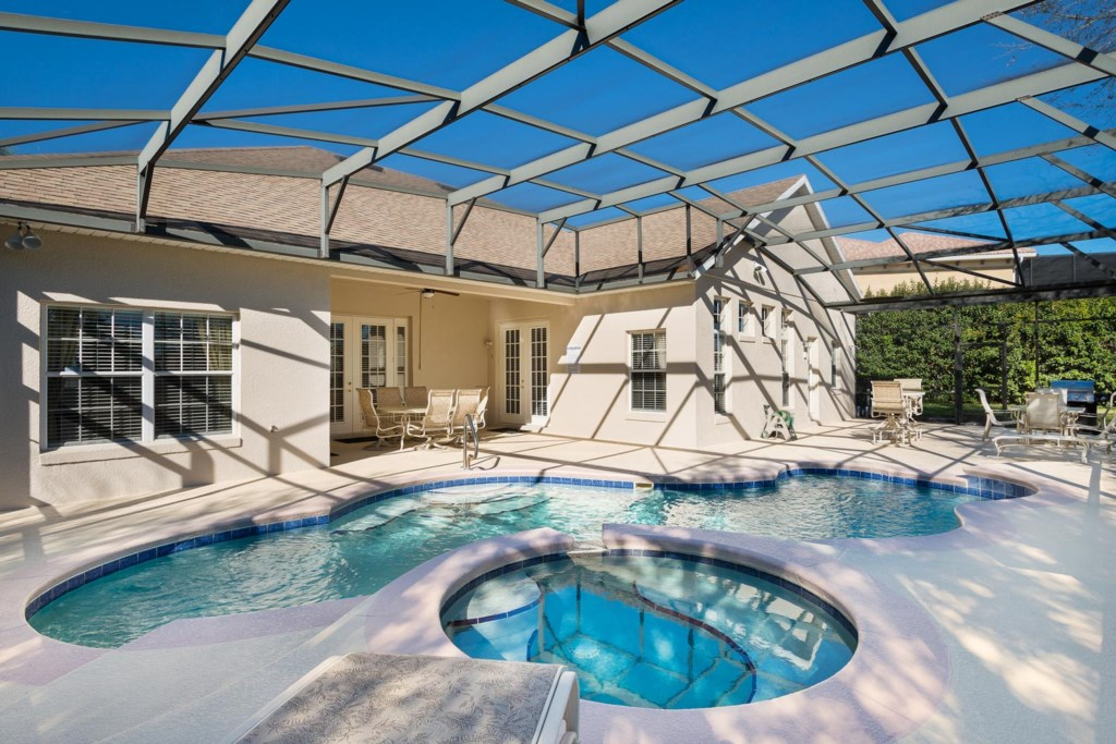 South-facing pool and spa with a private backyard, luxury patio furniture, barbecue grill & more