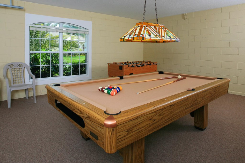 Game room with pool table, foosball table and more