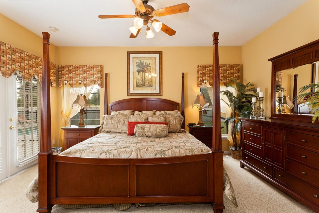 Luxurious downstairs main king master suite with 42-inch LCD TV, DVD player & ceiling fan