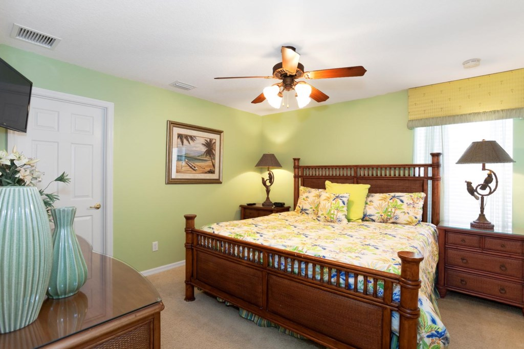 Inviting upstairs king master bedroom 3 with 32-inch LCD TV, DVD player & ceiling fan