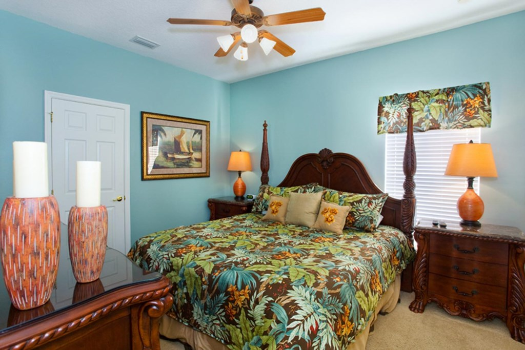 Decorative downstairs king master bedroom 4 with 32-inch LCD TV, DVD player & ceiling fan