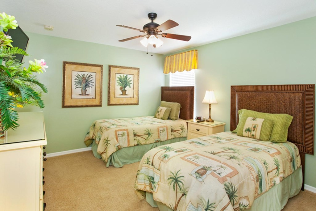 Cozy upstairs twin bedroom 5 with 32-inch LCD TV, DVD player & ceiling fan