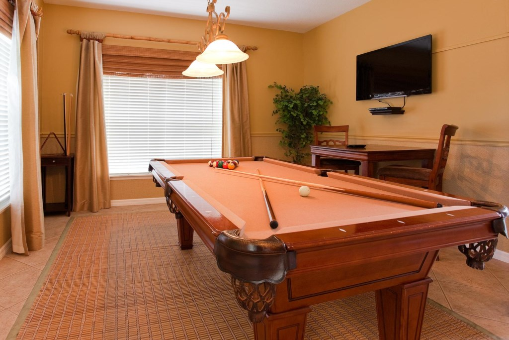 Elegant billiard room with 42-inch LCD TV and DVD player
