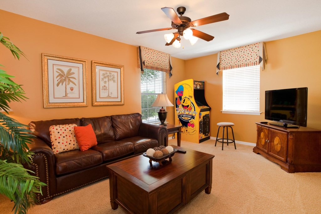 Game room with Pac Man/Galaga arcade machine, 42-inch LCD TV, DVD player, sleeper sofa & more