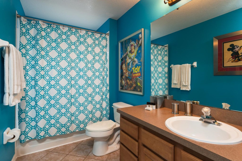 Upstairs hall bathroom 3 has fun Disney artwork