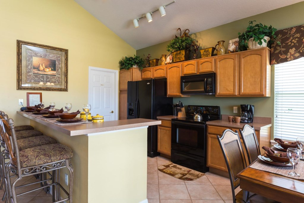Prepare meals in the fully equipped eat-in kitchen