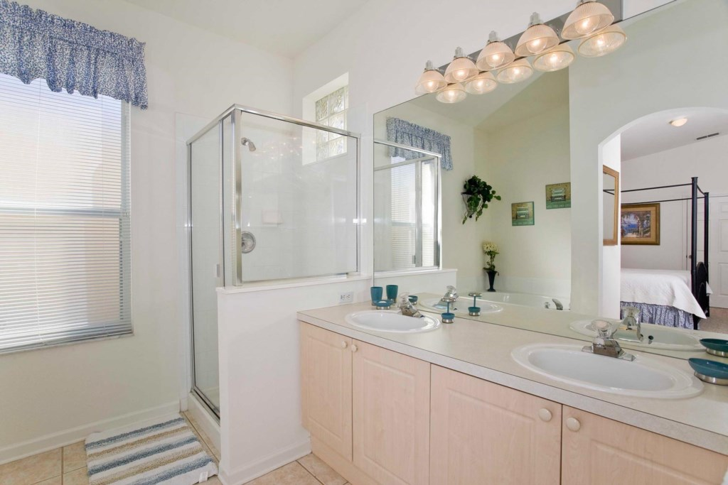 Suite 1 private bathroom with garden bathtub, glass door shower & two sinks