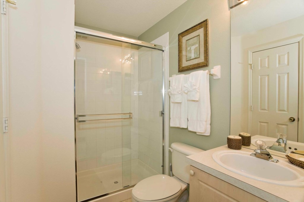 Suite 2 private bathroom with glass door shower