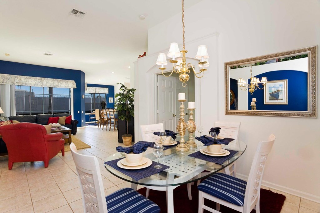The four-seat dining area features stylish maritime decor