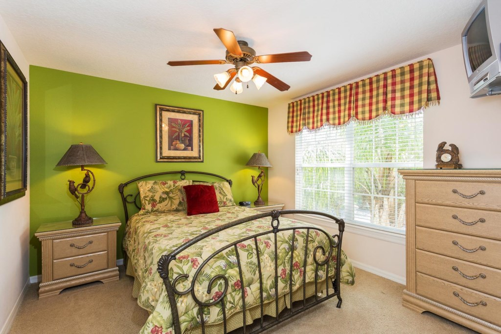 Decorative upstairs queen bedroom 4