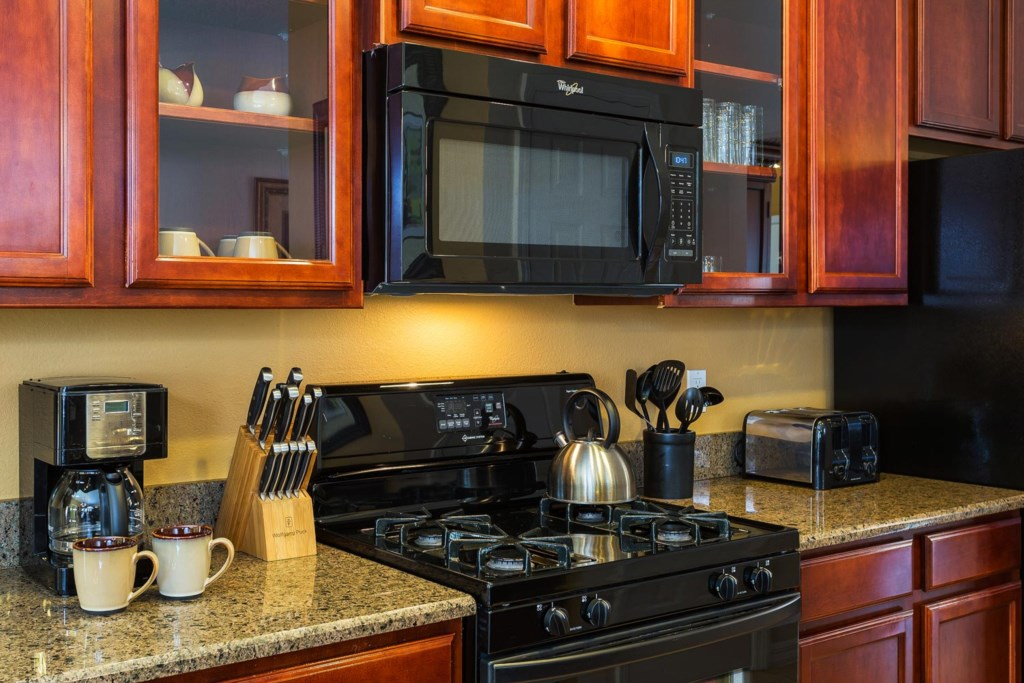 The kitchen features all major appliances including a gas stove