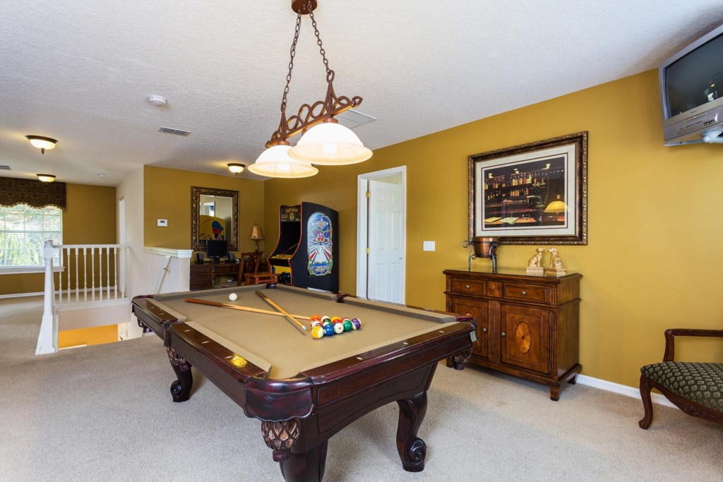 Shoot pool and watch your favorite sporting event in the game room