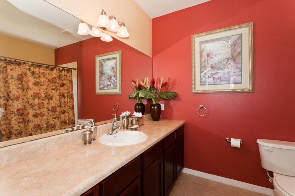 Downstairs main master bathroom with full bathtub & shower